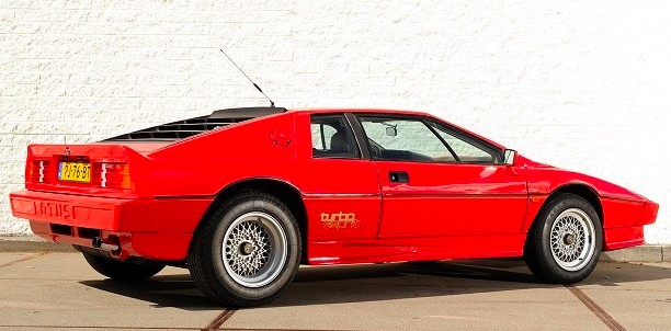 lotus esprit turbo hc parked in front of brick wall